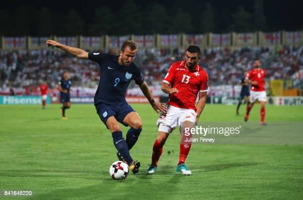 Harry Kane of England holds off Zach Muscat of Malta during the FIFA 2018 World Cup Qualifier between Malta and England at Ta'Qali National Stadium...