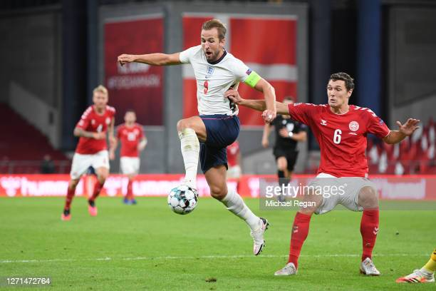 Harry Kane of England in action with Andreas Christensen of Denmark during the UEFA Nations League group stage match between Denmark and England at...