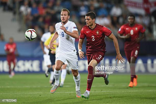 Harry Kane of England in action with Tiago Ilori of Portugal during the UEFA Under21 European Championship 2015 Group B match between England and...