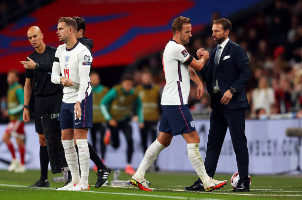 Harry Kane of England interacts with Gareth Southgate, Manager of England as he is substituted during the 2022 FIFA World Cup Qualifier match between...