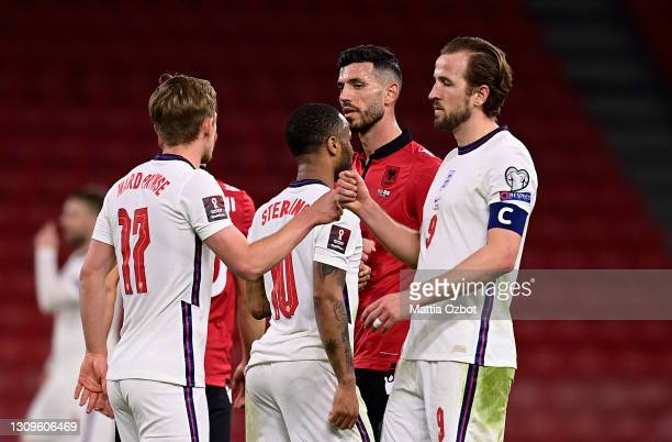 Harry Kane of England interacts with James Ward-Prowse following the FIFA World Cup 2022 Qatar qualifying match between Albania and England at the...
