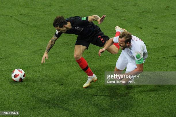 Harry Kane of England is brought down by Lovre Kalinic of Croatia during the 2018 FIFA World Cup Russia Semi Final match between England and Croatia...