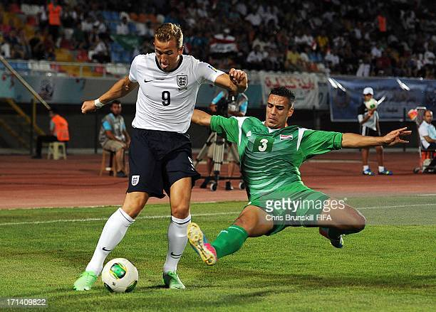 Harry Kane of England is challenged by Ali Adnan of Irag during the FIFA U20 World Cup Group E match between England and Iraq at Akdeniz University...