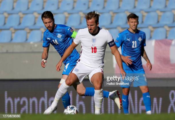 Harry Kane of England is challenged by Kari Arnason of Iceland during the UEFA Nations League group stage match between Iceland and England at...