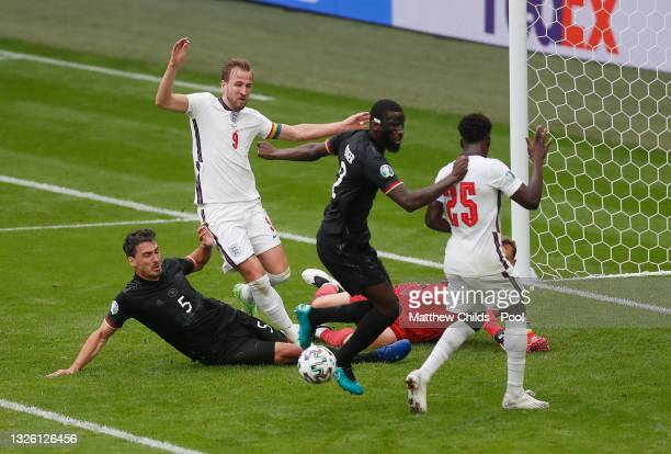 Harry Kane of England is challenged by Mats Hummels of Germany during the UEFA Euro 2020 Championship Round of 16 match between England and Germany...