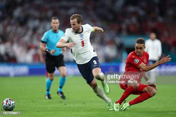Harry Kane of England is challenged by Yussuf Poulsen of Denmark during the UEFA Euro 2020 Championship Semi-final match between England and Denmark...