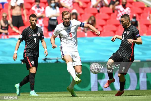 Harry Kane of England is closed down by Mateo Kovacic of Croatia during the UEFA Euro 2020 Championship Group D match between England and Croatia at...