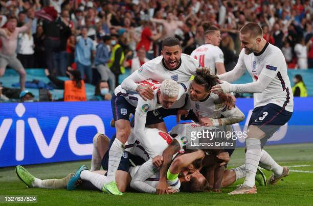 Harry Kane of England is congratulated after scoring his team's second goal by Jordan Henderson, Phil Foden, Kyle Walker, Jack Grealish, Raheem...