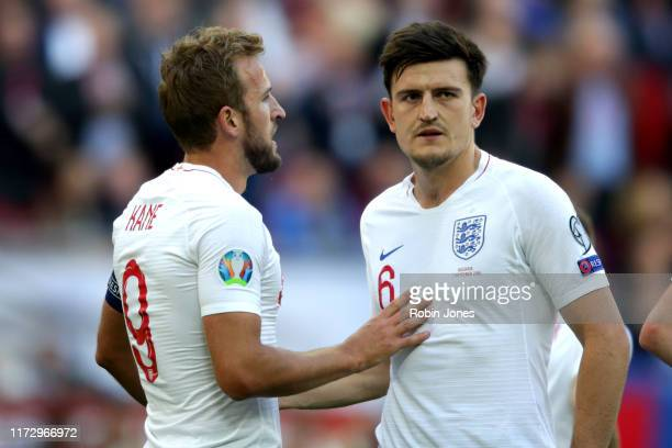 Harry Kane of England is congratulated by Harry Maguire after he scores a goal to make it 10 during the UEFA Euro 2020 qualifier match between...