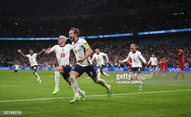 Harry Kane of England is congratulated by Phil Foden after scoring the second goal during the UEFA Euro 2020 Championship Semi-final match between...