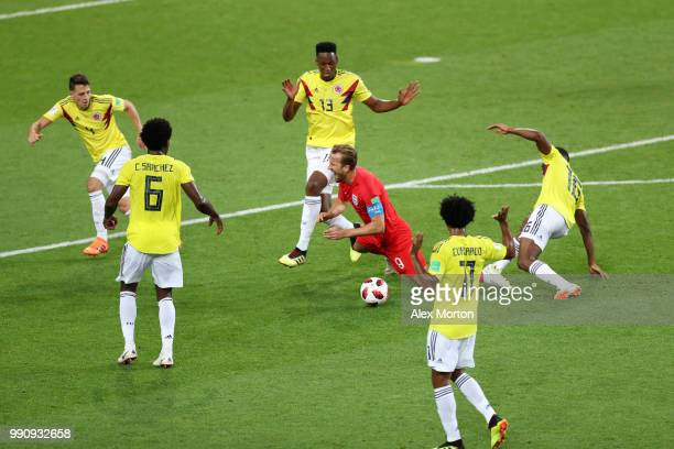 Harry Kane of England is fouled by Jefferson Lerma of Colombia outside Colombia penalty area during the 2018 FIFA World Cup Russia Round of 16 match...