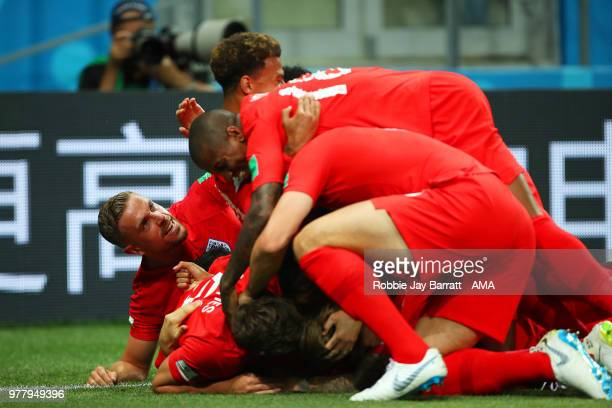 Harry Kane of England is mobbed by his teammates after scoring a goal to make it 01 during the 2018 FIFA World Cup Russia group G match between...