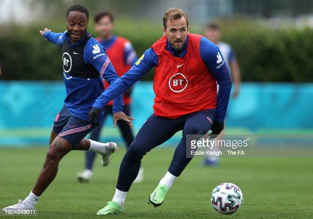 Harry Kane of England is put under pressure by Raheem Sterling during the England Training Session at Tottenham Hotspur Training Ground on June 20,...