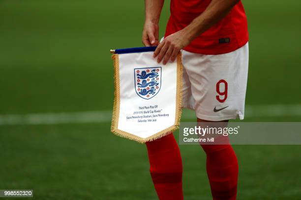 Harry Kane of England is seen holding the England pennant prior to the 2018 FIFA World Cup Russia 3rd Place Playoff match between Belgium and England...