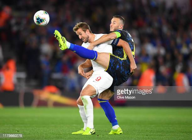 Harry Kane of England is tackled by Amir Rrahmani of Kosovo during the UEFA Euro 2020 qualifier match between England and Kosovo at St Mary's Stadium...