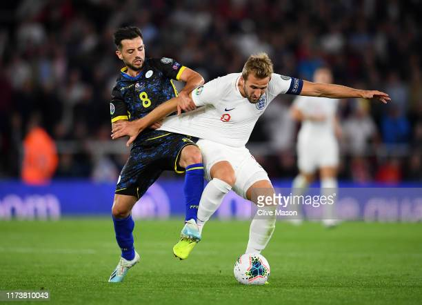 Harry Kane of England is tackled by Besar Halimi of Kosovo during the UEFA Euro 2020 qualifier match between England and Kosovo at St Mary's Stadium...
