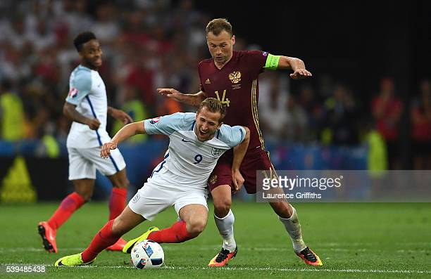 Harry Kane of England is tackled by Vasili Berezutski of Russia during the UEFA EURO 2016 Group B match between England and Russia at Stade Velodrome...