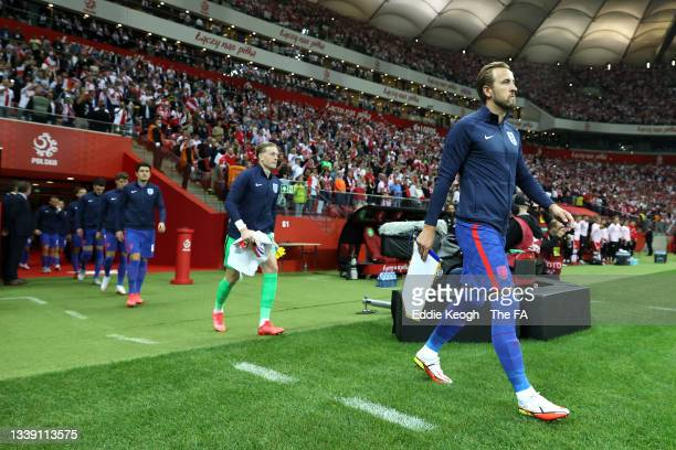 Harry Kane of England leads his teammates onto the pitch prior to the 2022 FIFA World Cup Qualifier match between Poland and England at Stadion...