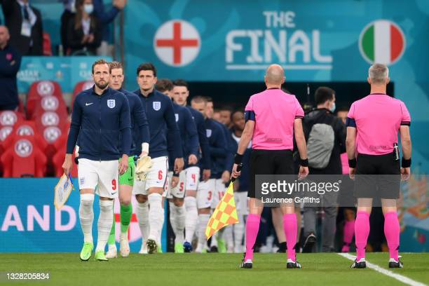 Harry Kane of England leads the team on to the pitch prior to the UEFA Euro 2020 Championship Final between Italy and England at Wembley Stadium on...
