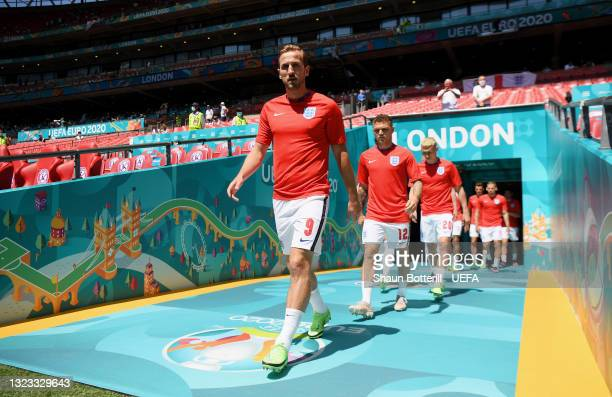 Harry Kane of England leads the team on to the pitch to warm up prior to the UEFA Euro 2020 Championship Group D match between England and Croatia at...