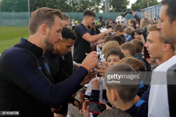 Harry Kane of England national team and his teammates sign autographs after an England national team opentopublic training session ahead of the FIFA...