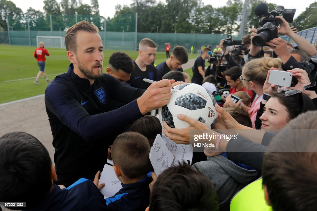 Harry Kane (L) of England national team signs autographs after an England national team training session ahead of the FIFA World Cup 2018 in Russia at Stadium Spartak Zelenogorsk on June 13, 2018 in Saint Petersburg, Russia.