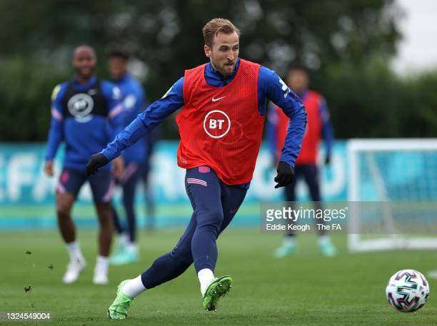 Harry Kane of England passes the ball during the England Training Session at Tottenham Hotspur Training Ground on June 20, 2021 in Burton upon Trent,...