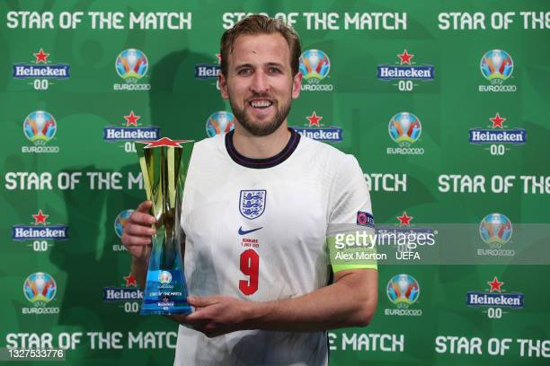 """Harry Kane of England poses for a photograph with the Heineken """"Star of the Match"""" award after the UEFA Euro 2020 Championship Semi-final match..."""