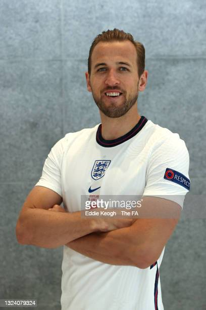 Harry Kane of England poses for a portrait wearing the England v Scotland match shirt at St George's Park on June 17, 2021 in Burton upon Trent,...