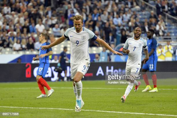 Harry Kane of England reacts after scoring during the International friendly match between France and England at Stade de France on June 13 2017 in...