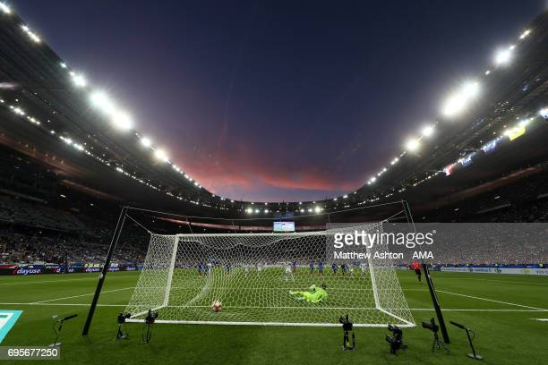 Harry Kane of England scores a goal from a penalty to make the score 2-2 during the International Friendly match between France and England at Stade...