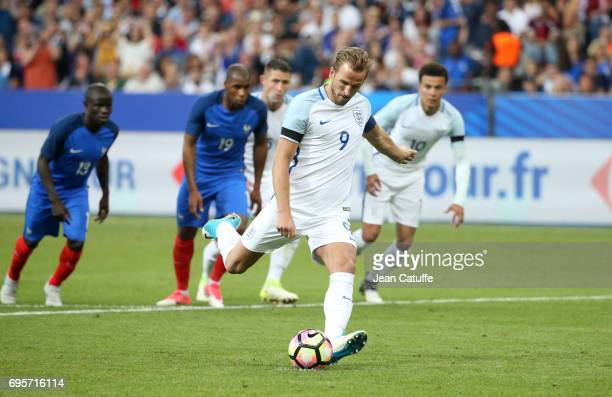Harry Kane of England scores a goal on a penalty kick during the international friendly match between France and England at Stade de France on June...