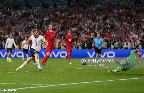 Harry Kane of England scores from the rebound of a missed penalty for their team's second goal during the UEFA Euro 2020 Championship Semi-final...