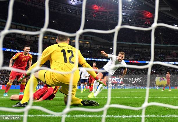 Harry Kane of England scores his sides fifth goal during the UEFA Euro 2020 qualifier between England and Montenegro at Wembley Stadium on November...