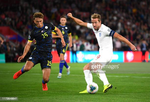 Harry Kane of England scores his sides second goal as he is closed down by Mergim Vojvoda of Bulgaria during the UEFA Euro 2020 qualifier match...
