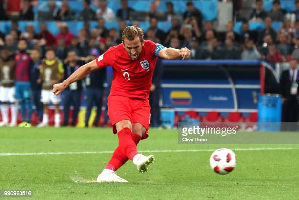 Harry Kane of England scores his team's first penalty in the penalty shoot out during the 2018 FIFA World Cup Russia Round of 16 match between...