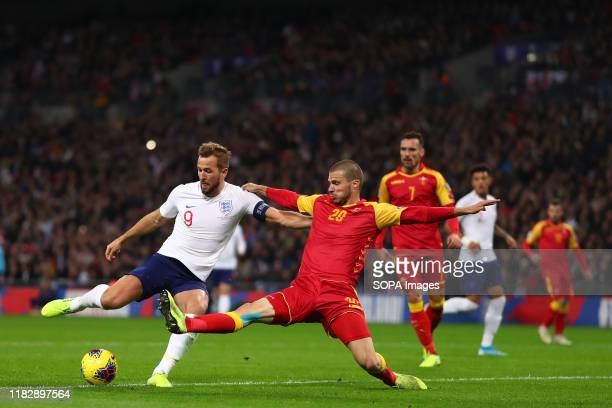 Harry Kane of England scores his third goal to make it 50 during the UEFA Euro 2020 qualifier match between England and Montenegro at Wembley Stadium...