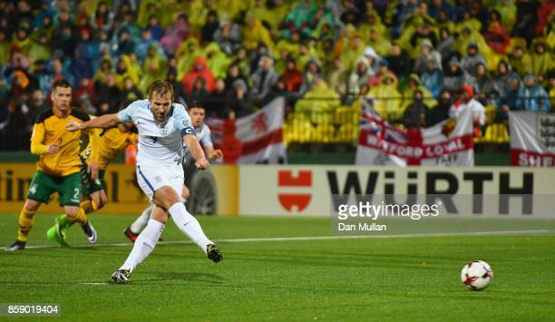 Harry Kane of England scores their first goal from the penalty spot during the FIFA 2018 World Cup Group F Qualifier between Lithuania and England at...