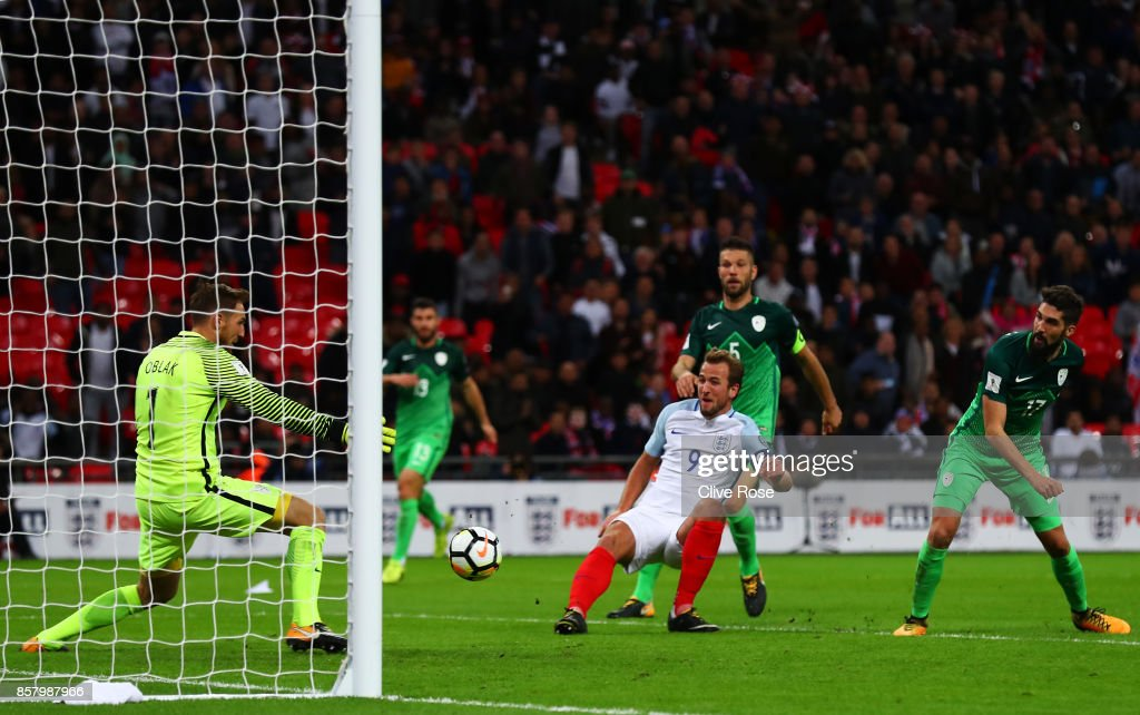 Harry Kane of England (9) scores their first goal past Jan Oblak of Slovenia during the FIFA 2018 World Cup Group F Qualifier between England and Slovenia at Wembley Stadium on October 5, 2017 in London, England.