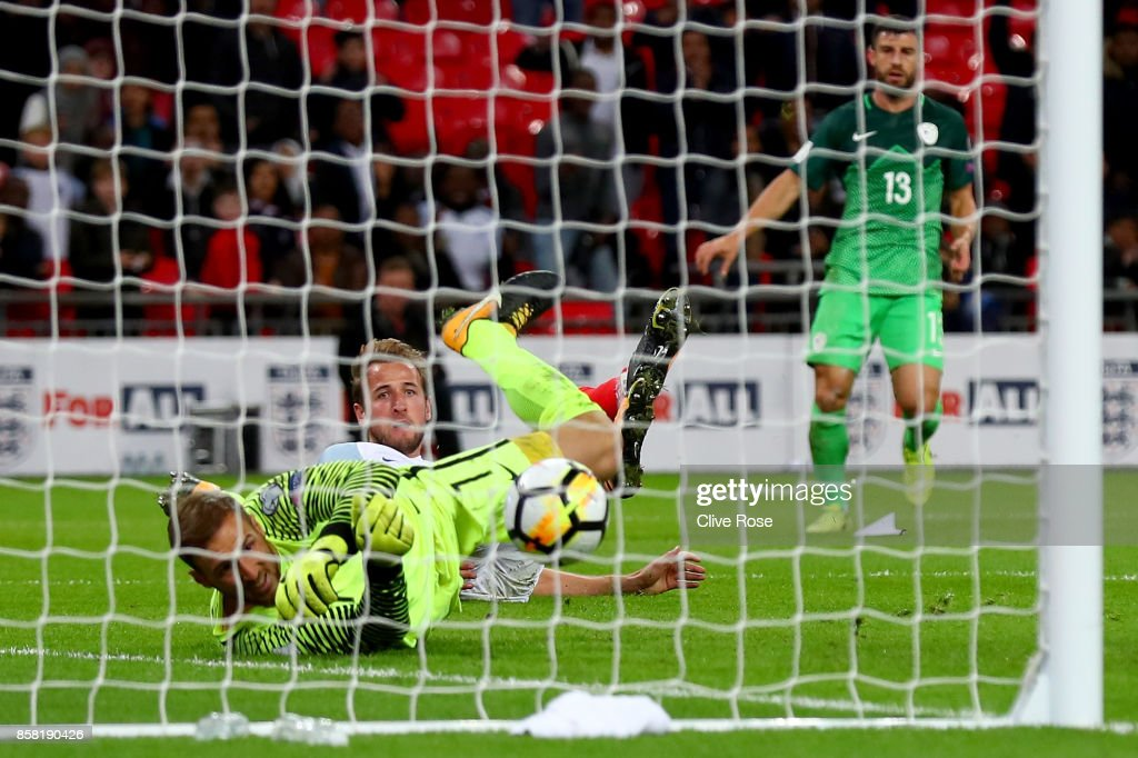 Harry Kane of England (9) scores their first goal past Jan Oblak of Slovenia during the FIFA 2018 World Cup Group F Qualifier between England and Slovenia at Wembley Stadium on October 5, 2017 in London, England..