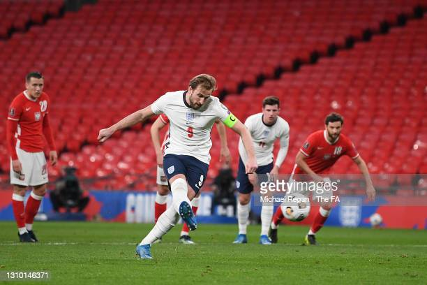 Harry Kane of England scores their side's first goal from the penalty spot during the FIFA World Cup 2022 Qatar qualifying match between England and...