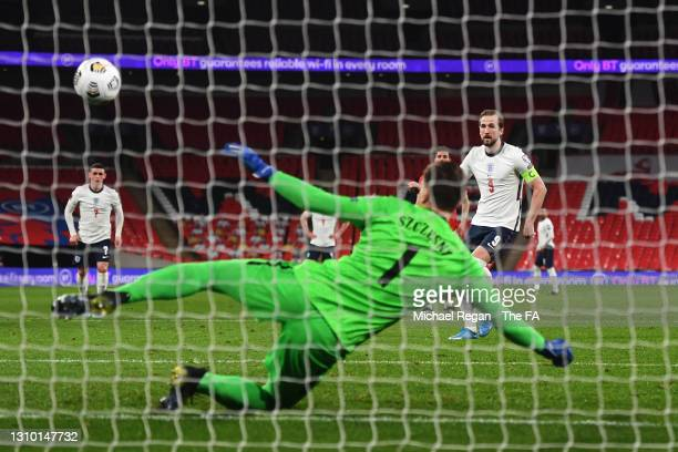 Harry Kane of England scores their side's first goal past Wojciech Szczesny of Poland from the penalty spot during the FIFA World Cup 2022 Qatar...