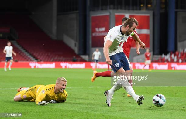 Harry Kane of England shoots and misses whilst Kasper Schmeichel of Denmark looks on during the UEFA Nations League group stage match between Denmark...