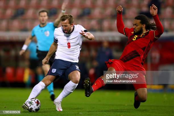 Harry Kane of England shoots on goal in front of Jason Denayer of Belgium during the UEFA Nations League group stage match between Belgium and...