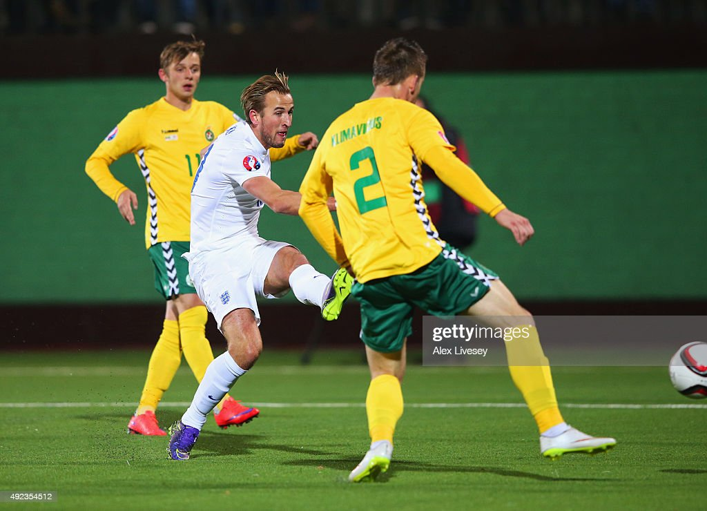 Harry Kane of England shoots past Linas Klimavicius of Lithuania (2), the ball then rebounds off goalkeeper Giedrius Arlauskis of Lithuania (not pictured) for an own goal and England's second during the UEFA EURO 2016 qualifying Group E match between Lithuania and England at LFF Stadionas on October 12, 2015 in Kaunas, Lithuania.