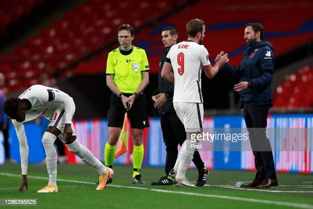 Harry Kane of England speaks to Gareth Southgate, Manager of England after being subbed during the UEFA Nations League group stage match between...