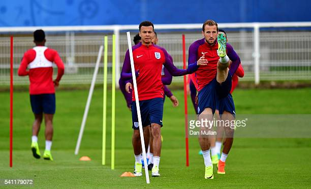 Harry Kane of England stretches alongside Dele Alli of England during a training session ahead of the UEFA Euro 2016 match against Slovakia at Stade...