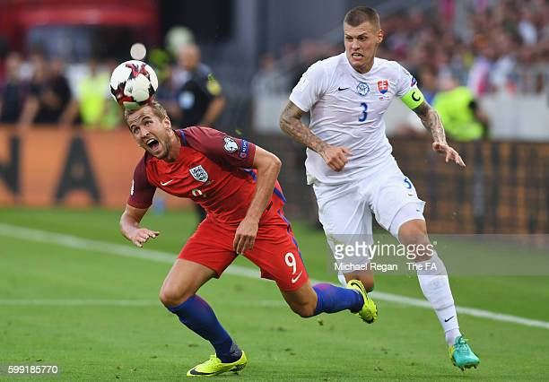 Harry Kane of England takes on Martin Skrtel of Slovakia during the 2018 FIFA World Cup Group F qualifying match between Slovakia and England at City...
