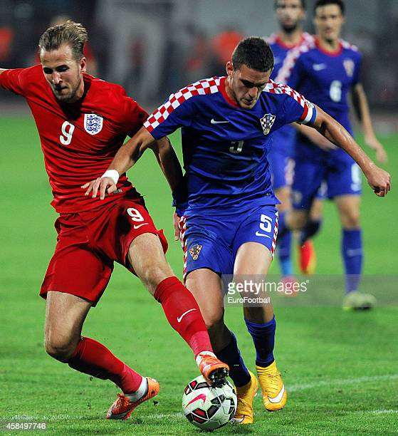 Harry Kane of England vies with Niko Datkovic of Croatia during the UEFA U21 Championship Playoff Second Leg match between Croatia and England at the...