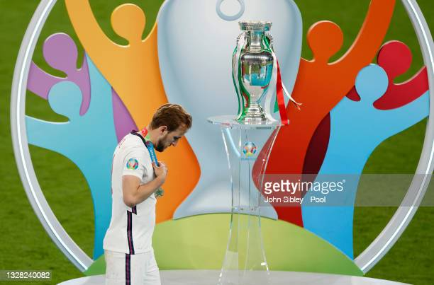 Harry Kane of England walks past the Henri Delaunay Trophy following his team's defeat in the UEFA Euro 2020 Championship Final between Italy and...